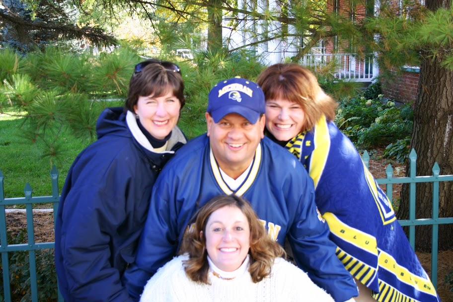 October 22, 2005:  Dennis and his ladies pose outside of an alcoholics anonymous facility (no joke) where we tailgated before Michigan defeated Iowa 23-20.