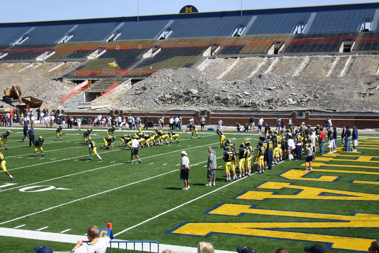 April 16, 2005:  A seat reconstruction project provides an apocalyptic backdrop for Henne, Hart, and Avant during the 2005 Michigan Spring Game.