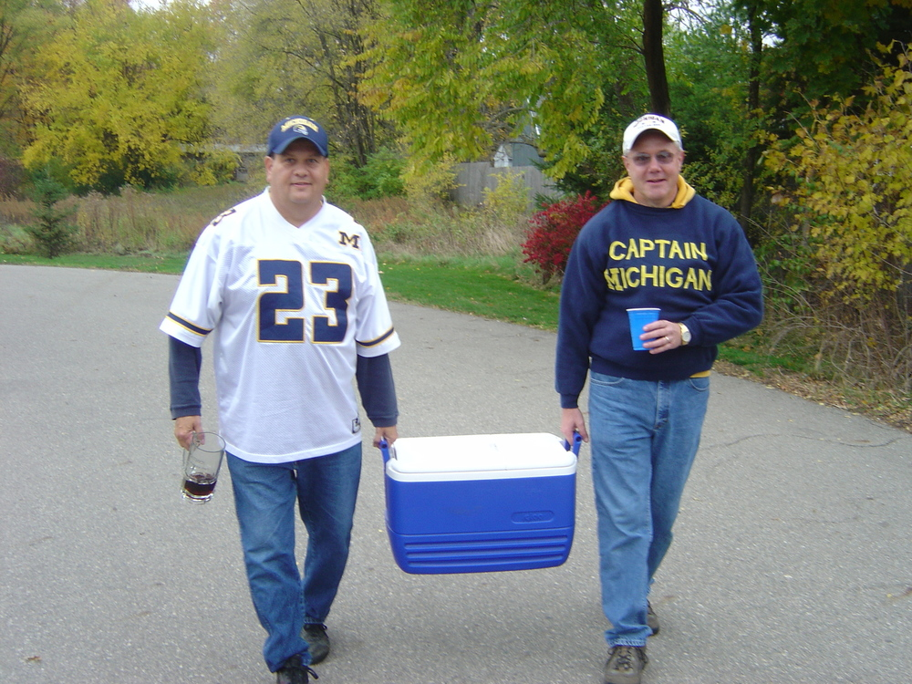 November 1, 2003:  Godfather and Captain carry a cooler to the tailgate spot before  Michigan's 27-20 victory over the Spartans in East Lansing .