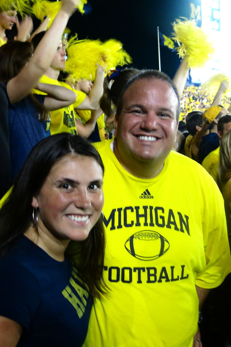 9/7/13 Michigan 41-ND 30:   Lisa and Frankie pose among the celebrating students.