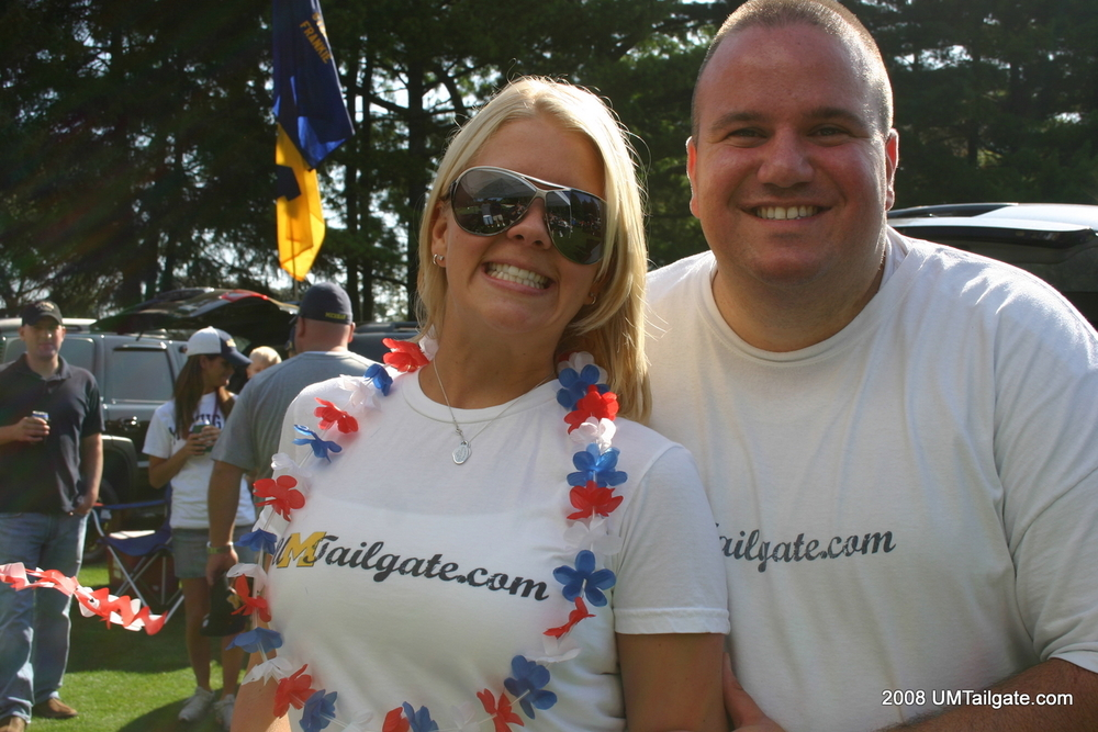 August 30, 2008:  The Princess and The Webmaster pose in their UMTailgate.com t-shirts (later the University declared them illegal) before Rich Rod's opener and  a loss to the Utes 27-25 .  Also, today is her birthday, so happy birthday!