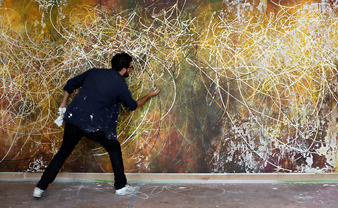 "Jose Parla with his painting ""Gesture Performing Dance, Dance Performing Gesture."""