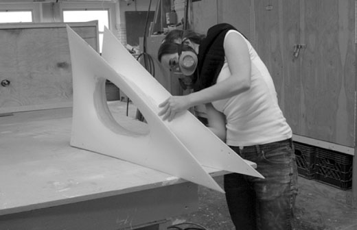 Candelabra » Zoe Coombes finishing the fiberglass connection between the two halves of a component at PS-1