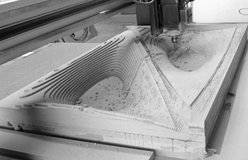 SCI-Arc's 3-axis mill carving a mold out of laminated particle board