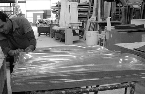 David Boira removing the first vacuum forming test at the Warner Brothers set building shop in L.A.