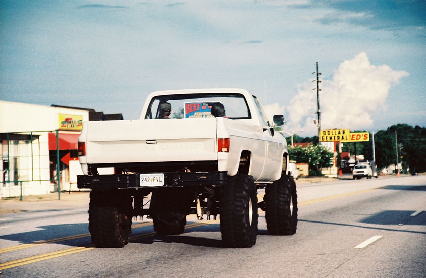 White Pick Up Truck With Mudders