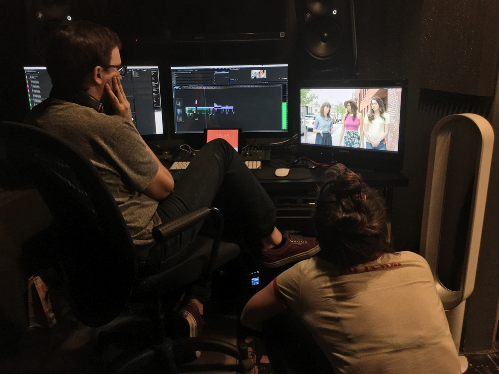 Paul and Corinne watching rough cuts. Corinne doesn't need a chair.