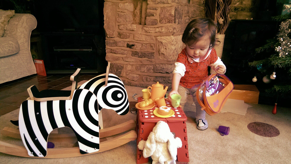 Grace Feeding Zebra Rocker