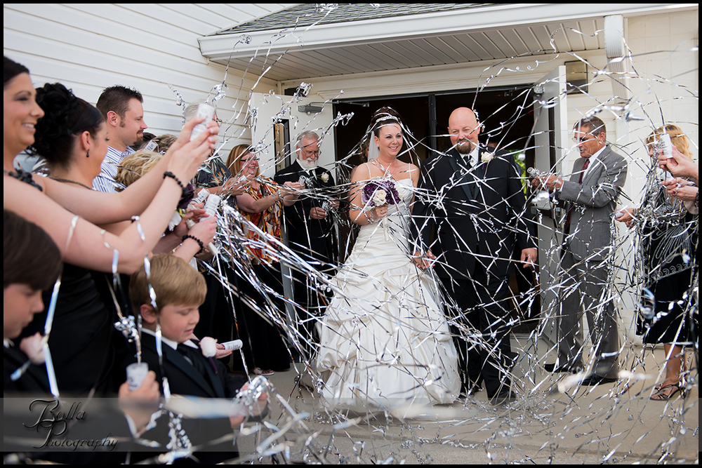 008_wedding_church_groom_bride_exit_streamers.jpg