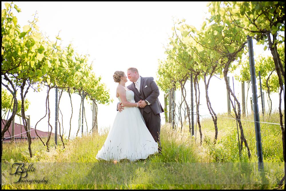 001-villa-marie-winery-maryville-il-wedding-bride-groom-kiss-vineyard.jpg