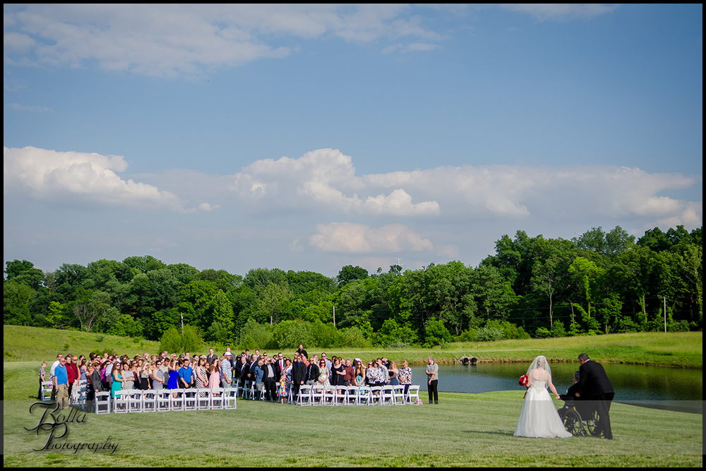007-villa-marie-winery-maryville-il-wedding-bride-father-procession-wheelchair-outdoor-clouds.jpg