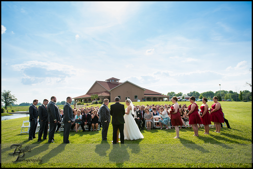 010-villa-marie-winery-maryville-il-wedding-groom-bride-outdoor-ceremony-clouds.jpg