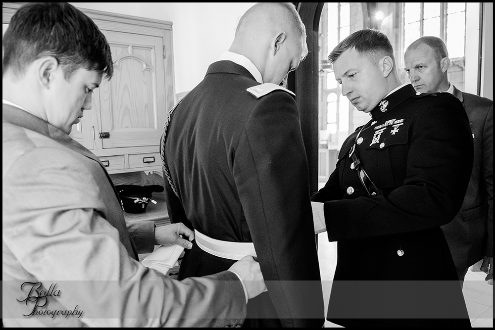 003-provincial_house_chapel-saint_louis-mo-wedding-groom-preparations-military-uniform.jpg