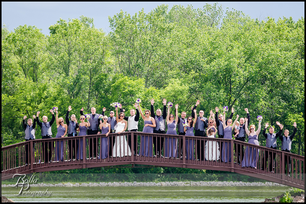 013_Bolla_Photography-wedding-portraits-bride-groom-couple-bridal_party-purple-bridesmaids-sunglasses-groomsmen-cheer-bridge-Mascoutah-Reservoir-Hibbs.jpg