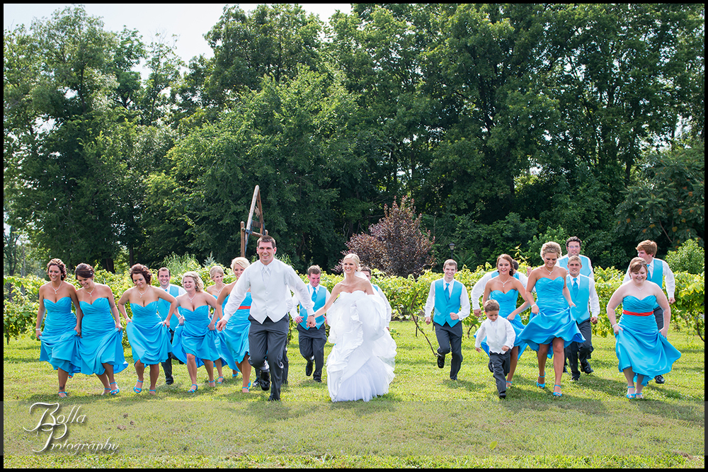 013_Bolla_Photography-wedding-portraits-bride-groom-bridal_party-running-turquoise-bridesmaids-groomsmen-winery-vineyard-Aviston-Gerstner.jpg