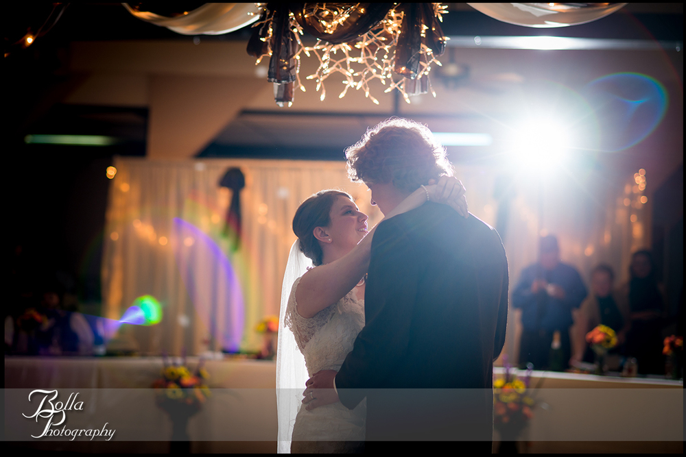 013_Bolla_Photography-fall-wedding-reception-first_dance-backlit-chandelier-flare-Highland-Kuhl.jpg