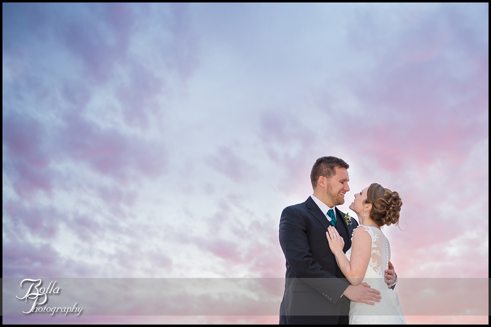 001-Bolla-Photography-Saint-Louis-wedding-photographer-McKendree-Bothwell-Chapel-Lebanon-IL-ceremony-Regency-OFallon-IL-reception-bride-groom-portraits-night-couple-sunset-clouds-kissing-McClain.jpg