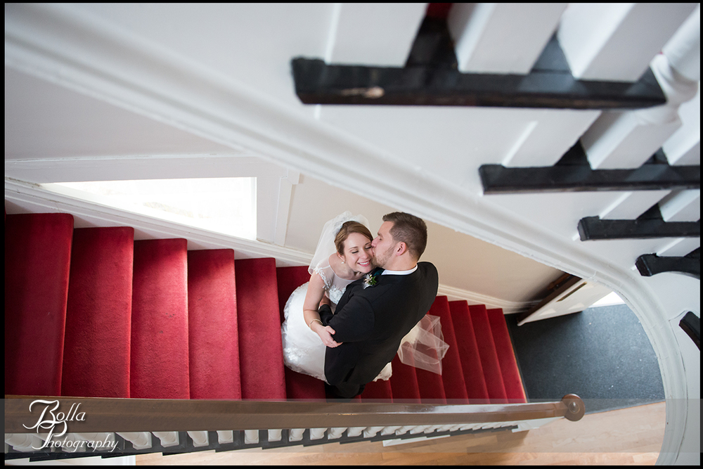 013-Bolla-Photography-Saint-Louis-wedding-photographer-McKendree-Bothwell-Chapel-Lebanon-IL-ceremony-Regency-OFallon-IL-reception-bride-groom-kiss-stairwell-stairs-McClain.jpg