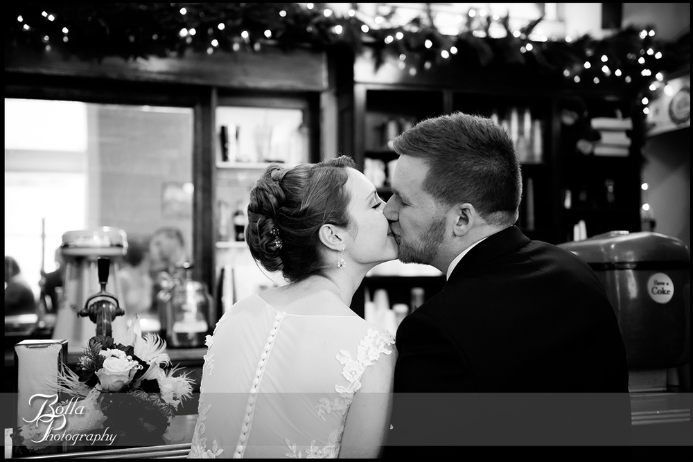 015-Bolla-Photography-Saint-Louis-wedding-photographer-McKendree-Bothwell-Chapel-Lebanon-IL-ceremony-Regency-OFallon-IL-reception-bride-groom-kiss-milkshake-mirror-McClain.jpg