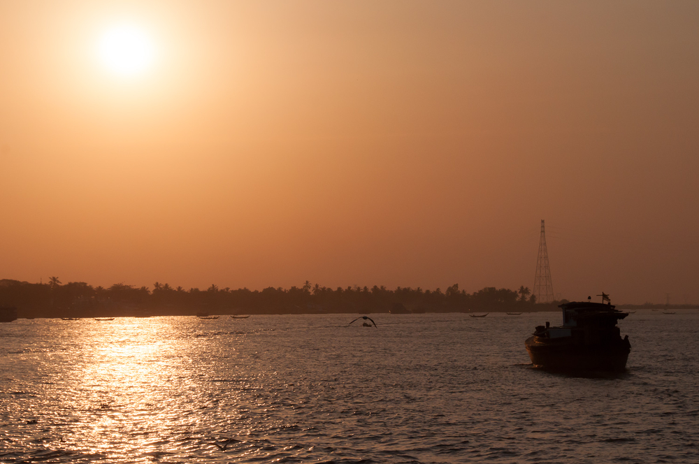 The sun sets over the Yangon river