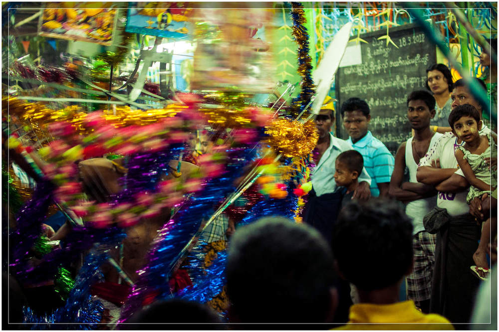 Onlookers watch as the devotees spin and dance to the undulating beat as they enter the temple and the ceremony comes to an end.    © Dustin Main 2013