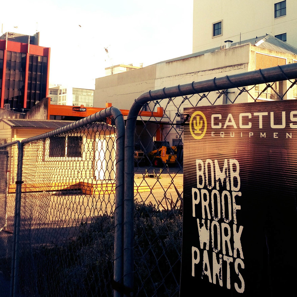 """Bomb Proof Work Pants"" An advertisement has an interesting choice of words for a place where it looks as though a bomb could have literally gone off. Christchurch, New Zealand."