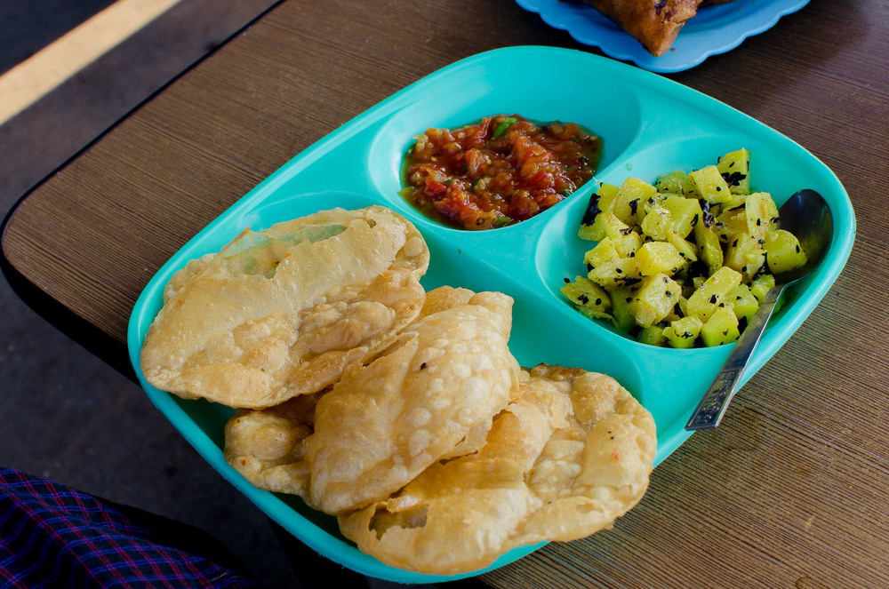 Puri is my breakfast of choice at Shwe Ya Minn.  Three puri bread with a side of potato curry and a side of spicy tomato purry will set you back 300 kyat (~$0.35).  (c) Dustin Main 2013
