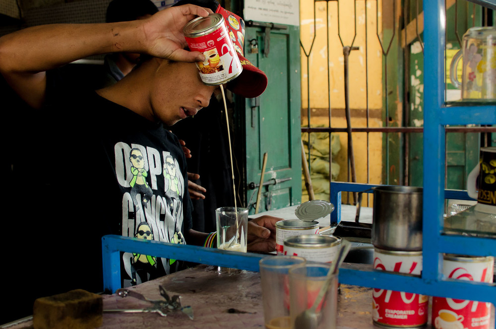 "Laphet-yeh step one with ""tea master"" Mg Naing: condensed milk  (c) Dustin Main 2013"