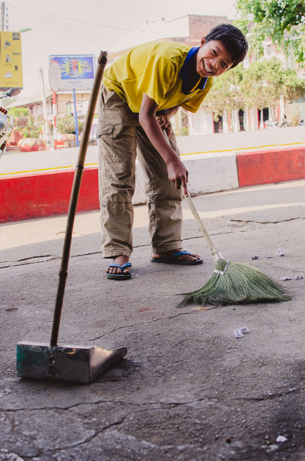 Soe Than cleans up after the morning rush.  Kalaw, Myanmar (Burma) (c) Dustin Main 2013