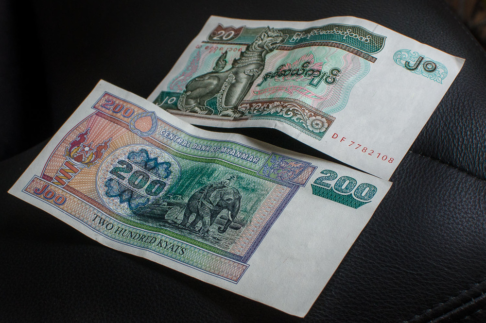 Myanmar Kyat.  The combined value of these two bills is ~$0.25USD (May 2013)