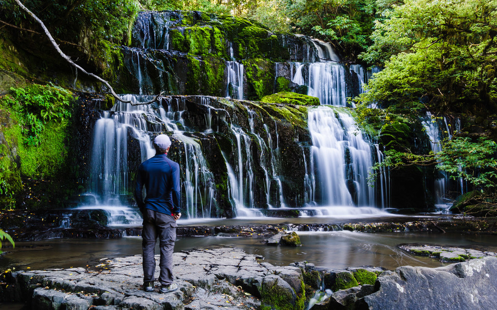 Taking in the beautiful Purakaunui Falls in New Zealand's quiet Catlins. © Dustin Main 2013