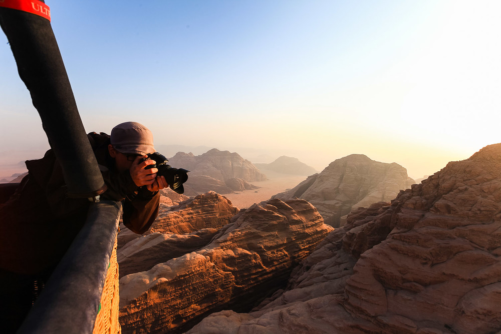 Shooting the morning sun as it kisses the mountains of Wadi Rum in Jordan.  © Dustin Main 2013