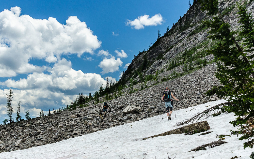 Dale hiking in the snow on the other side of Summer Pass.  Yeah, I get it... it's called Summer Pass, and we had a snowball fight there in July. © Dustin Main 2014