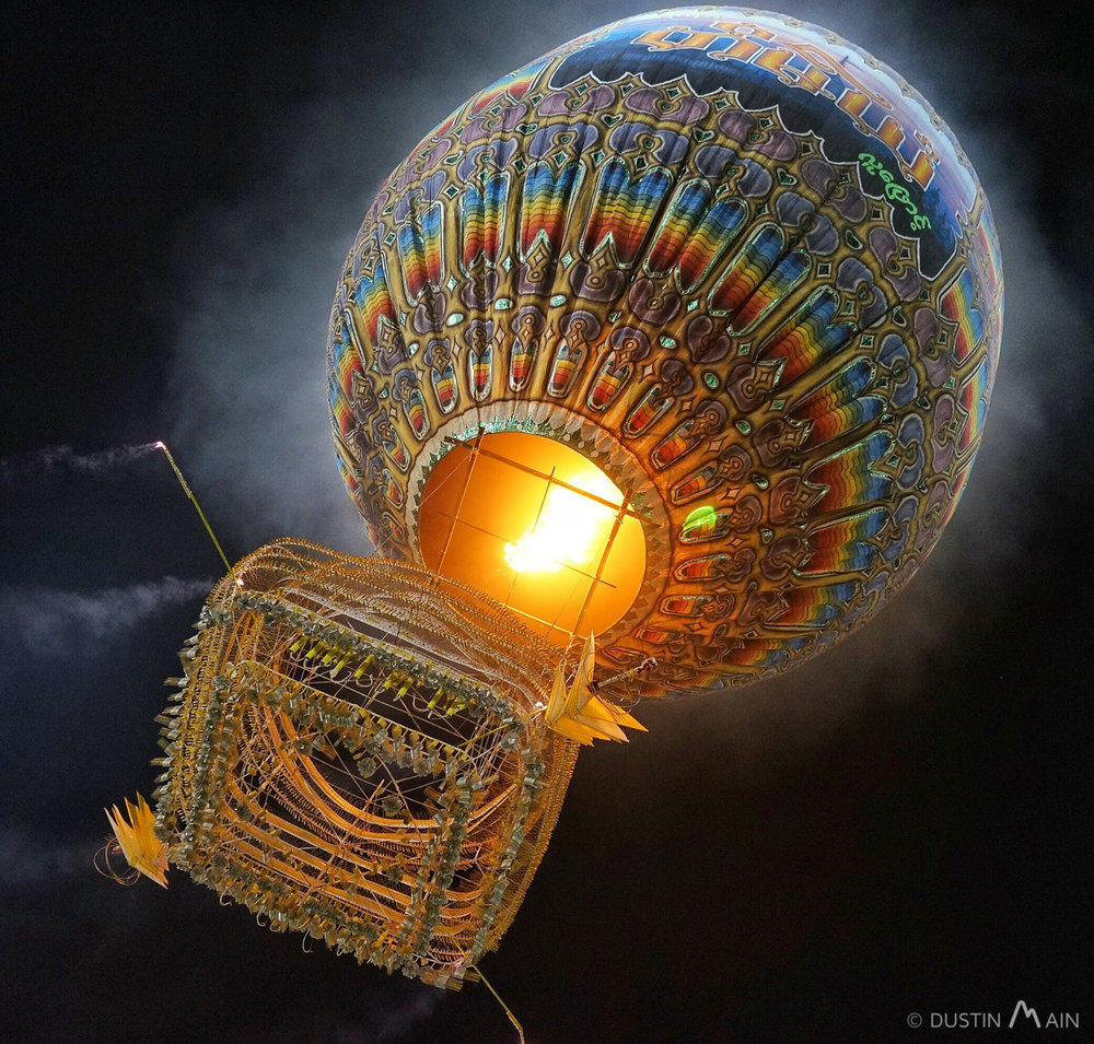 A fire balloon launches for the Tazaungdaing festival in Taunggyi.  You have to see it to believe it...