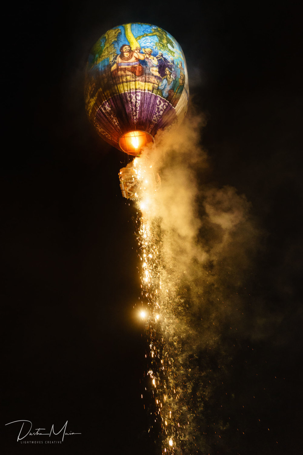 The fireworks on a fire balloon in Myanmar begin to go off.  © Dustin Main 2015