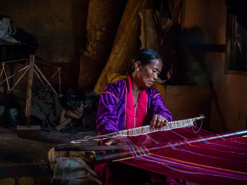 Danu woman back-strap weaving in rural Shan State