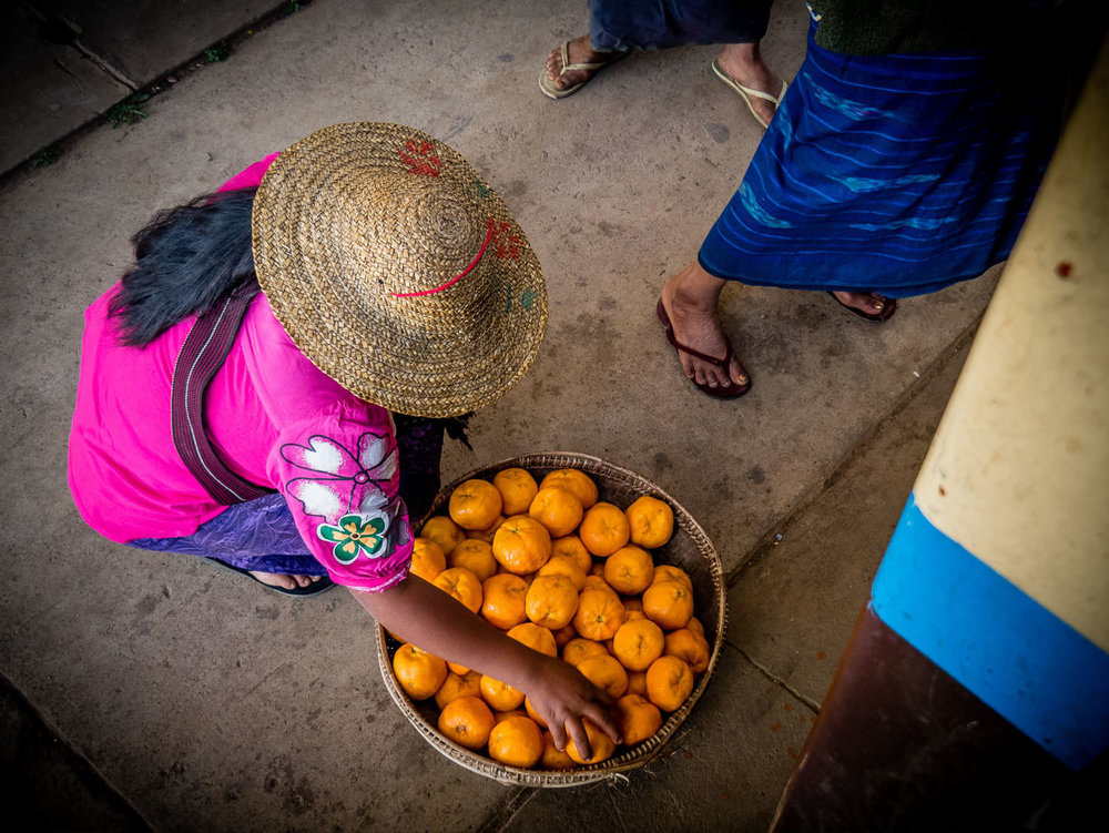 Selling oranges at the train station