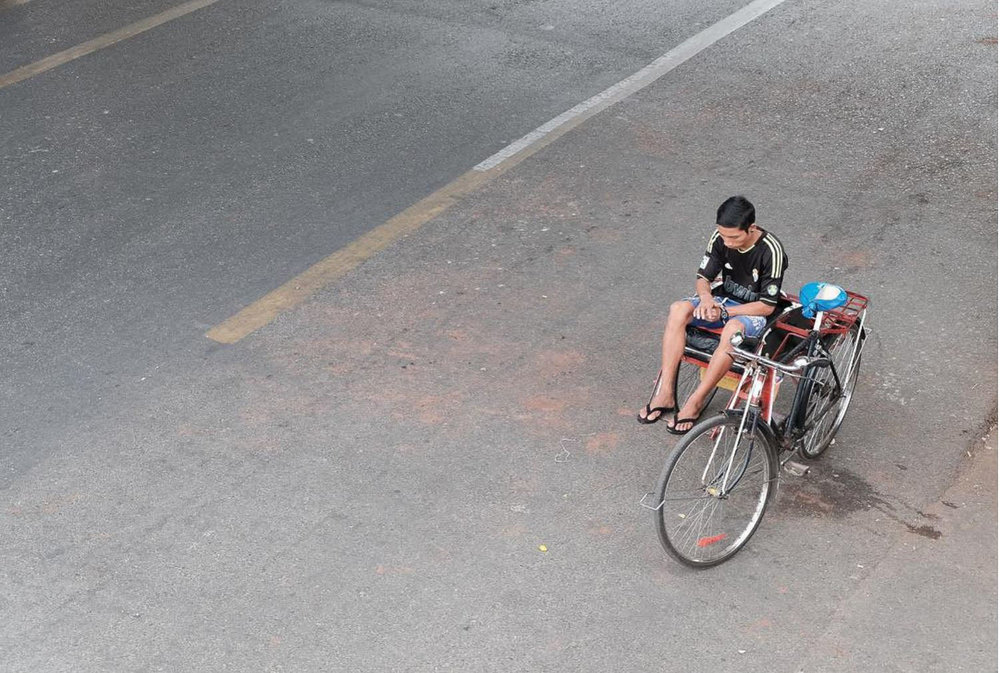 The rare trishaw on an empty street - Downtown Yangon