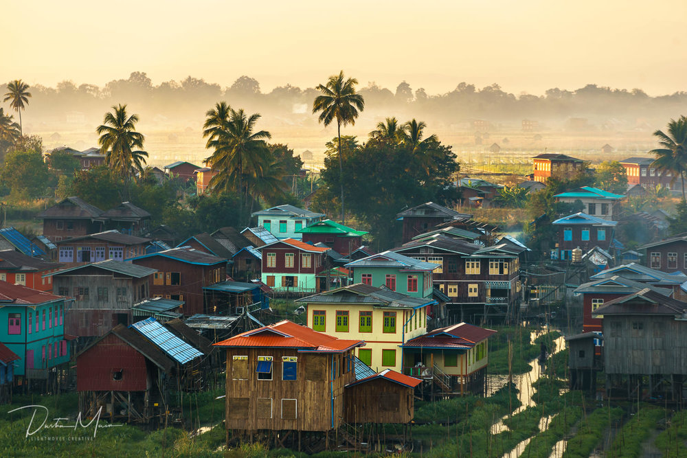 The bright colors of the houses in the floating village, moments before being drenched in the rays of the rising sun.  © Dustin Main 2017