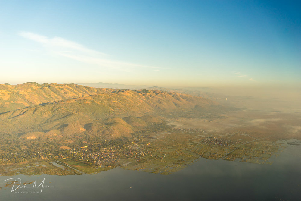 The view from high above Inle Lake. We were above the peaks of the mountain ridges to the east and west. Note the haze as this was taken half way through winter (mid-Jan)  © Dustin Main 2017