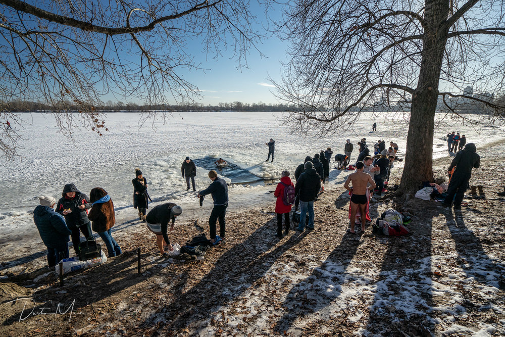 Participants disrobe on the banks of the river on a cold but sunny January 19th in Kyiv during Epiphany. © Dustin Main 2019