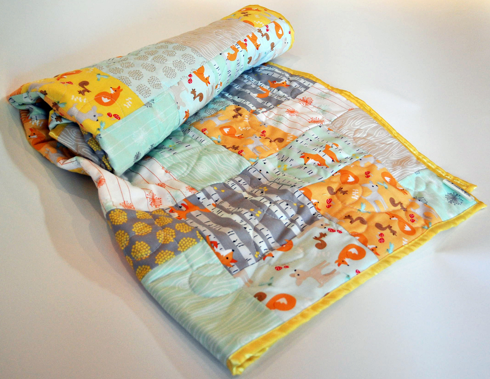 """""""Good Natured"""" woodlands cotton and satin baby quilt"""