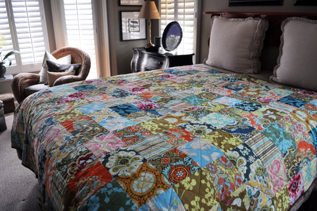 """Patchwork quilt in """"Belle"""" by Amy Butler"""