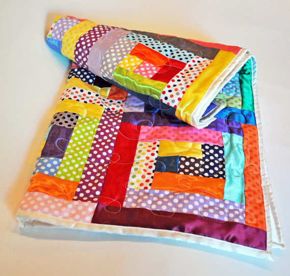 Cotton and satin polka dot baby quilt