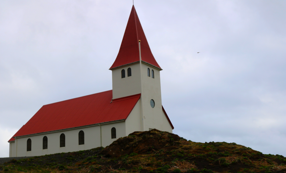 Vik I Myrdal, the town church sits above the town of Vik, which is the regional hub for everything in Southeast Iceland.
