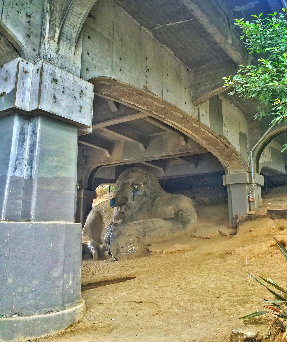 Under the Aurora Bridge, the Fremont Troll waits patiently.