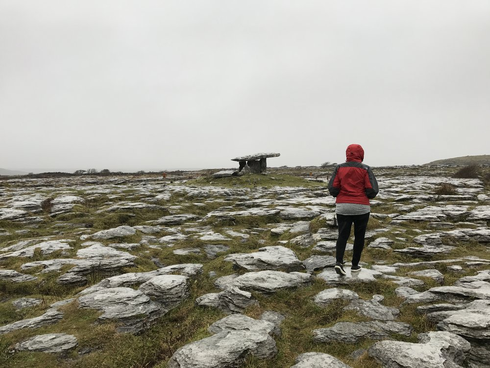 To visit Poulnabrone, visitors must traverse a short section of the rocks of the Burren.