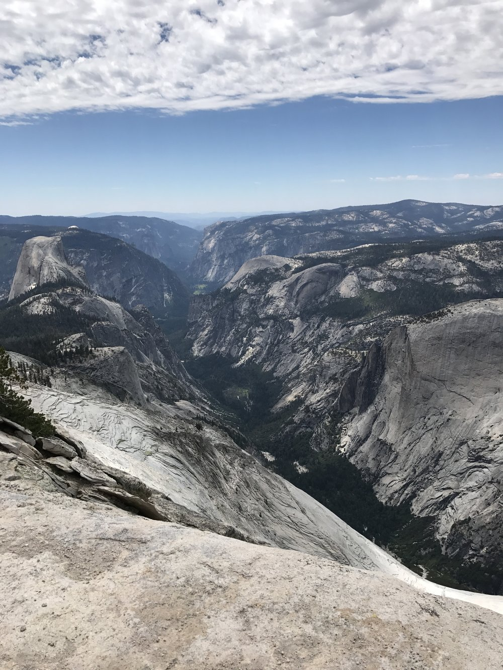 The summit has excellent views of the whole park, including Tenaya Canyon and Half Dome