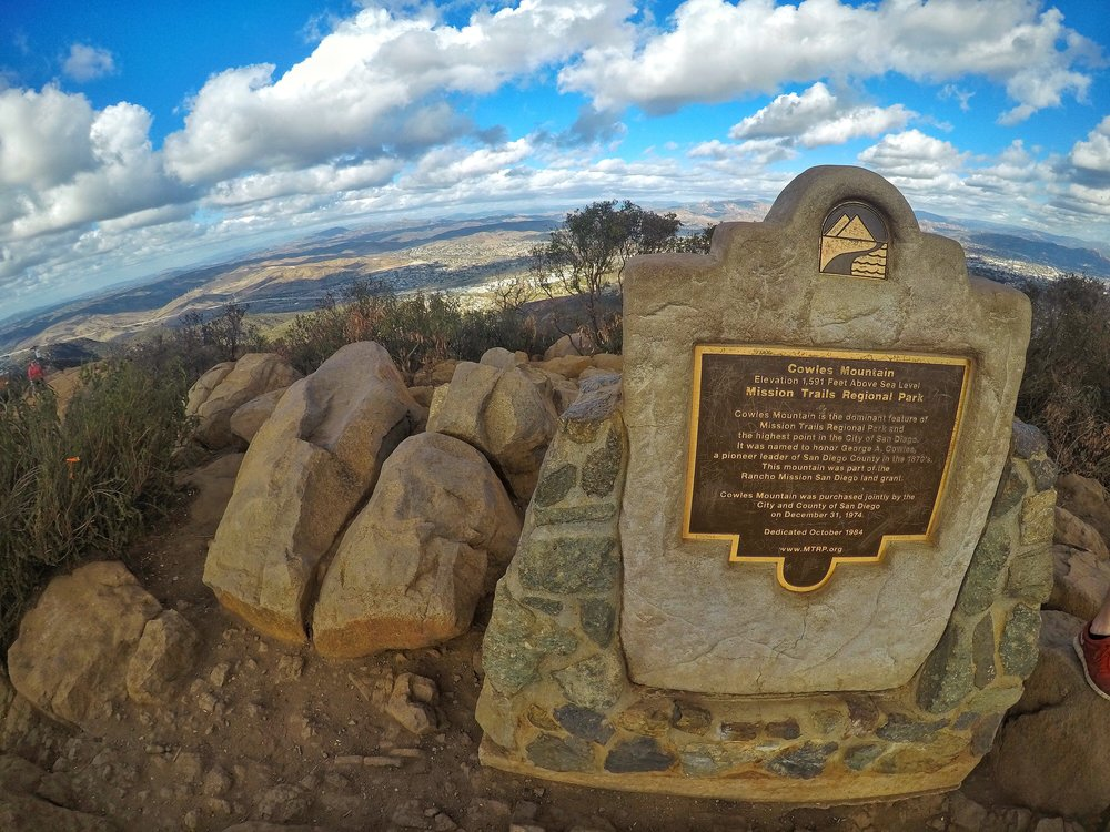The summit marker on Cowles is a popular spot for pictures, and selfies.