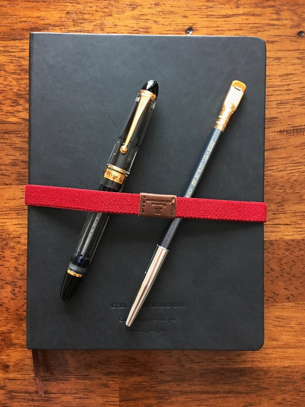 One of each: Pilot Custom 823, Blackwing 602, Apica CD